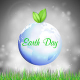 Υπόβαθρο γήινης ημέρας με τις λέξεις, τον μπλε πλανήτη, τα πράσινες φύλλα και τη χλόη επίσης corel σύρετε το διάνυσμα απεικόνισης Στοκ φωτογραφία με δικαίωμα ελεύθερης χρήσης