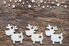 Υπόβαθρο διακοπών Χριστουγέννων Τάρανδος και αστέρι στον ξύλινο πίνακα Στοκ φωτογραφία με δικαίωμα ελεύθερης χρήσης