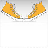 Υπόβαθρο εγγράφου δύο πορτοκαλί πάνινων παπουτσιών Στοκ Φωτογραφία