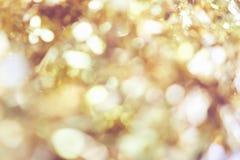 Υπόβαθρο θαμπάδων του χρυσού φωτός χρώματος bokeh, σχέδιο για τις όμορφες ταπετσαρίες στοκ εικόνες