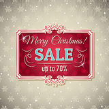 Υπόβαθρο και ετικέτα Χριστουγέννων με την προσφορά πώλησης Στοκ Φωτογραφίες