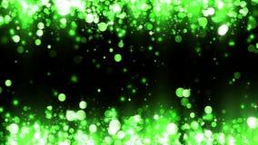 Υπόβαθρο με τα λαμπρά πράσινα μόρια Ακτινοβολώντας μόρια Όμορφο ελαφρύ υπόβαθρο bokeh Πράσινο κομφετί που λαμπυρίζει, φως απόθεμα βίντεο