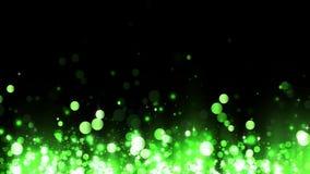 Υπόβαθρο με τα λαμπρά πράσινα μόρια Όμορφο ελαφρύ υπόβαθρο bokeh Ακτινοβολώντας μόρια αύξησης Πράσινο λαμπύρισμα κομφετί απόθεμα βίντεο