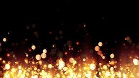 Υπόβαθρο με τα λαμπρά χρυσά μόρια Ακτινοβολώντας χρυσά μόρια αύξησης Όμορφο ελαφρύ υπόβαθρο bokeh Χρυσό κομφετί φιλμ μικρού μήκους