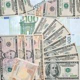 Υπόβαθρο με τα δολάρια και τα ευρώ Στοκ Εικόνα