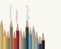 Υπόβαθρο με τα χρωματισμένα μολύβια σε ένα ελαφρύ υπόβαθρο Στοκ Φωτογραφίες