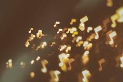 Υπόβαθρο μουσικής, ήχου και αφηρημένο θαμπάδων σημειώσεων Στοκ Φωτογραφίες