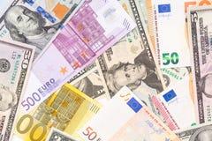 Υπόβαθρο που γίνεται από τα τραπεζογραμμάτια ευρώ και δολαρίων Στοκ Εικόνες