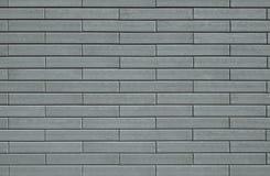 Υπόβαθρο προτύπων με μια σύσταση τοίχων που γίνεται από τα γκρίζα τούβλα Στοκ φωτογραφία με δικαίωμα ελεύθερης χρήσης