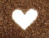 Υπόβαθρο πλαισίων καρδιών φιαγμένο από φασόλια καφέ Στοκ Φωτογραφία