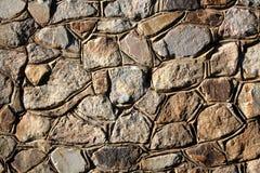 Υπόβαθρο - συσσωρευμένος πέτρινος τοίχος Στοκ Φωτογραφία