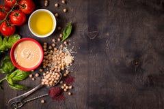 Υπόβαθρο συστατικών Hummus Στοκ Φωτογραφία