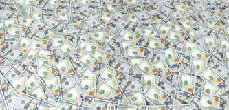Υπόβαθρο σωρών δολαρίων στοκ εικόνα