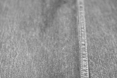 Υπόβαθρο σύστασης της μαλακής εστίασης τζιν, πίσω θαμπάδα, γραπτή Στοκ Φωτογραφία