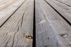 Υπόβαθρο σύστασης των ξύλινων πινάκων με το ρηχό βάθος του τομέα Στοκ φωτογραφία με δικαίωμα ελεύθερης χρήσης