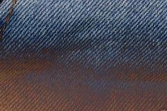 Υπόβαθρο σύστασης υφάσματος του Jean, κάποιο μέρος του κοντού μπλε τηγανιού Jean Στοκ Εικόνες