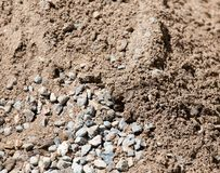 Υπόβαθρο της άμμου και του αμμοχάλικου στοκ φωτογραφίες