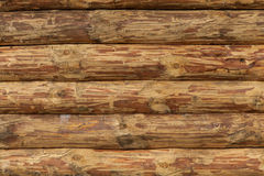 Υπόβαθρο της ξύλινης σύστασης τοίχων των επεξεργασμένων κούτσουρων Στοκ Εικόνα