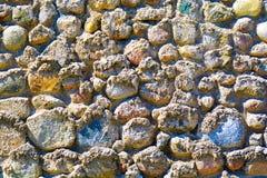 Υπόβαθρο της παλαιάς φωτογραφίας σύστασης τοίχων πετρών Ζωηρόχρωμος παλαιός τοίχος πετρών Στοκ Εικόνα