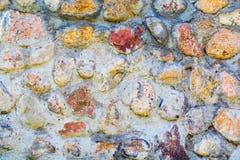 Υπόβαθρο της παλαιάς φωτογραφίας σύστασης τοίχων πετρών Ζωηρόχρωμος παλαιός τοίχος πετρών Στοκ φωτογραφία με δικαίωμα ελεύθερης χρήσης