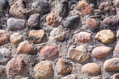 Υπόβαθρο της παλαιάς φωτογραφίας σύστασης τοίχων πετρών Ζωηρόχρωμος παλαιός τοίχος πετρών Στοκ Εικόνες