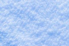 Υπόβαθρο της φρέσκιας σύστασης χιονιού στους μπλε τόνους Χειμώνας χιονιού και έννοια Χριστουγέννων Στοκ Εικόνες