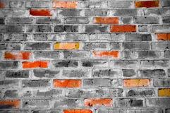 Υπόβαθρο τουβλότοιχος με τα χρωματισμένα τούβλα στοκ φωτογραφία