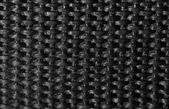 Υπόβαθρο του μαύρου υφάσματος Μακροεντολή στοκ φωτογραφίες