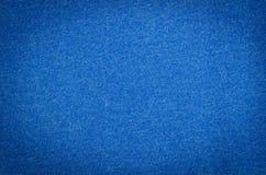Υπόβαθρο του μπλε κλωστοϋφαντουργικού προϊόντος ή του υφάσματος Στοκ Φωτογραφίες