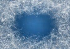 Υπόβαθρο του μπλε χρώματος με snowflakes και τα παγωμένα σχέδια Στοκ Εικόνες