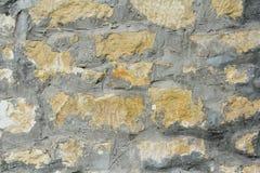Υπόβαθρο του τοίχου πετρών με τη φωτογραφία σύστασης τσιμέντου Στοκ Φωτογραφίες