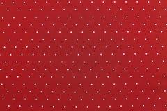 Υπόβαθρο του υφάσματος κόκκινου χρώματος με στρογγυλά specks Στοκ Εικόνες