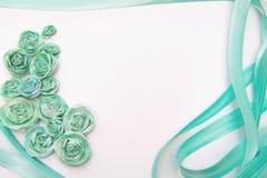 Υπόβαθρο τριαντάφυλλων και κορδελλών Στοκ Φωτογραφίες