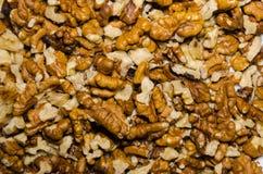 υπόβαθρο των καθαρισμένων πυρήνων ξύλων καρυδιάς στοκ εικόνα