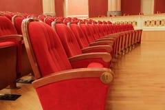 Υπόβαθρο των κόκκινων θεατρικών κόκκινων καρεκλών Στοκ εικόνες με δικαίωμα ελεύθερης χρήσης