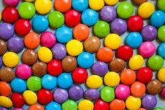Υπόβαθρο των πολύχρωμων γλυκών Στοκ Εικόνες