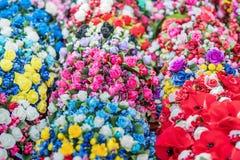 Υπόβαθρο των τεχνητών λουλουδιών Στοκ Φωτογραφία