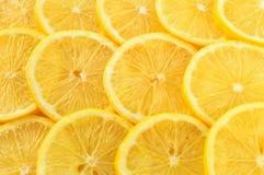 Υπόβαθρο των φετών λεμονιών κορυφαία όψη στοκ εικόνα