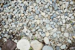 Υπόβαθρο χαλικιών Η σύσταση των πετρών Όμορφο σκηνικό στοκ φωτογραφία