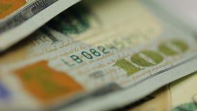 υπόβαθρο χρημάτων μετρητών Το πορτρέτο του Benjamin Franklin στενό σε επάνω λογαριασμών 100 αμερικανικών δολαρίων, η εικόνα περισ φιλμ μικρού μήκους