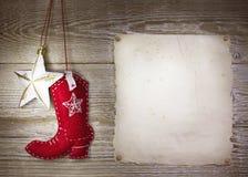 Υπόβαθρο Χριστουγέννων κάουμποϋ με τη δυτική μπότα παιχνιδιών και αστέρι στο ο Στοκ Εικόνες