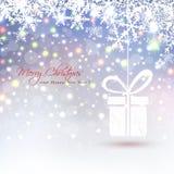 Υπόβαθρο Χριστουγέννων με αφηρημένα κρεμώντας snowflakes κιβωτίων δώρων και τα χρωματισμένα φω'τα Στοκ Εικόνα