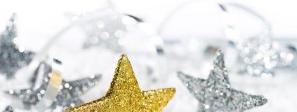 Υπόβαθρο Χριστουγέννων με τα αστέρια Χριστουγέννων Στοκ Εικόνες