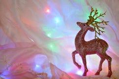 Υπόβαθρο Χριστουγέννων με τα ελάφια Χριστουγέννων στοκ εικόνες