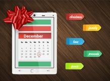 Υπόβαθρο Χριστουγέννων με την ταμπλέτα, το ημερολόγιο, τις αυτοκόλλητες ετικέττες και το τόξο Χριστουγέννων Στοκ εικόνες με δικαίωμα ελεύθερης χρήσης