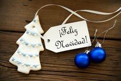 Υπόβαθρο Χριστουγέννων με τους ισπανικούς χαιρετισμούς Χριστουγέννων Στοκ Εικόνες