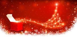 Υπόβαθρο Χριστουγέννων με το μαγικό κιβώτιο Στοκ εικόνες με δικαίωμα ελεύθερης χρήσης