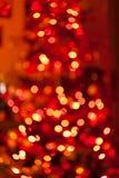 Υπόβαθρο χριστουγεννιάτικων δέντρων bokeh Ακτινοβολήστε και ανάψτε την περίληψη Στοκ Εικόνα