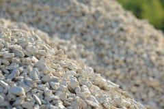 Υπόβαθρο Breakstone Οδικό αμμοχάλικο Σύσταση αμμοχάλικου συντριμμένο αμμοχάλικο Σωροί των βράχων ασβεστόλιθων Πέτρες σπασιμάτων σ στοκ εικόνα