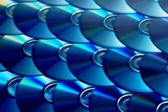 Υπόβαθρο CD Διάφοροι δίσκοι blu-ακτίνων Cd dvd Οπτικά recordable ή επαναγράψιμα μέσα αποθήκευσης ψηφιακών στοιχείων Στοκ εικόνες με δικαίωμα ελεύθερης χρήσης